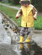 Child Splashing in rain